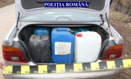 FOTO: Un albaiulian este cercetat de poliţişti după ce a încercat să fure motorină din rezervorul unui camion, dar a fost prins
